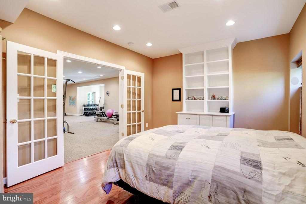 French doors and built ins in lower level bedroom - 43705 MAHOGANY RUN CT, LEESBURG