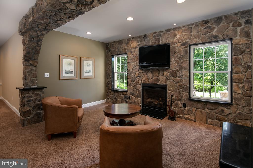 Custom stone hearth makes a cozy sitting area - 19030 COTON FARM CT, LEESBURG