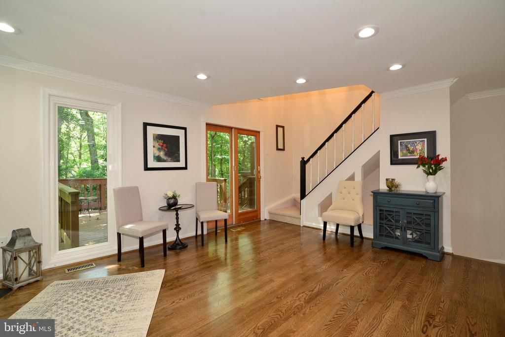Living room and stairs to upper level - 11296 SILENTWOOD LN, RESTON