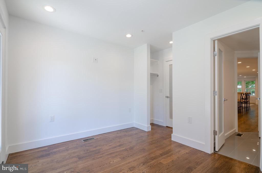 Rich dark- stained  oak floors - 1412 SHEPHERD ST NW #1, WASHINGTON