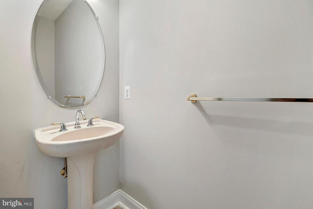 Main-Level Powder Room with Tile Floor - 19883 NAPLES LAKES TER, ASHBURN