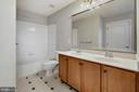 Hall Bath with Dual Vanities and Tile Flooring - 19883 NAPLES LAKES TER, ASHBURN