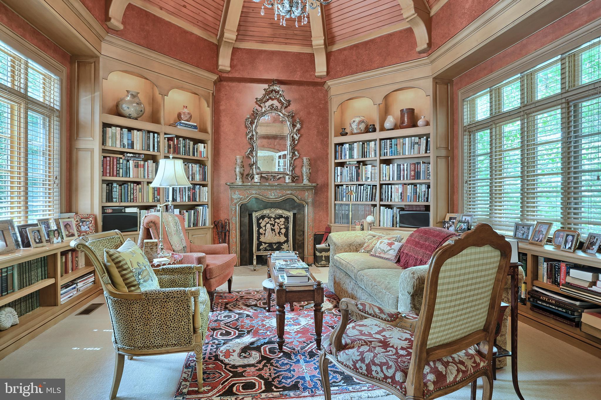 Library features vaulted ceiling and built-ins