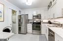 Kitchen with Carrera marble counter tops - 1800 OLD MEADOW RD #1020, MCLEAN