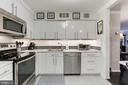 Kitchen with new flooring - 1800 OLD MEADOW RD #1020, MCLEAN
