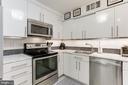 Kitchen w/new subway backsplash & pencil molding - 1800 OLD MEADOW RD #1020, MCLEAN