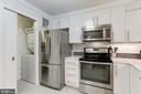 Kitchen with pocket door to pantry & laundry - 1800 OLD MEADOW RD #1020, MCLEAN