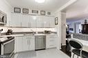 Kitchen open to formal Dining Room - 1800 OLD MEADOW RD #1020, MCLEAN