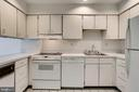 All white kitchen with plenty of cabinet space - 1955 WINTERPORT CLUSTER, RESTON