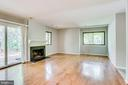Sliding glass doors lead out to large deck - 1955 WINTERPORT CLUSTER, RESTON