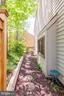 Small side yard w/ stone walkway - 1955 WINTERPORT CLUSTER, RESTON