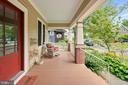 Wide, welcome front porch - at nearly 300 sq ft! - 1604 N CLEVELAND ST, ARLINGTON