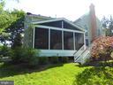 Screen porch with wood burning fireplace - 12809 SHADOW OAK LN, FAIRFAX