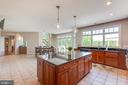 Kitchen with large island - 17072 SILVER CHARM PL, LEESBURG