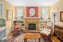 Handmade tile surrounds the gas fireplace - 1604 N CLEVELAND ST, ARLINGTON