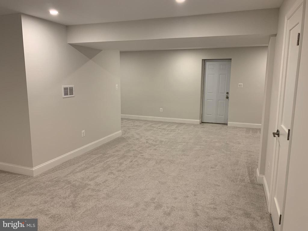 Basement recreation room & walk out egress door. - 14182 WYNGATE DR, GAINESVILLE