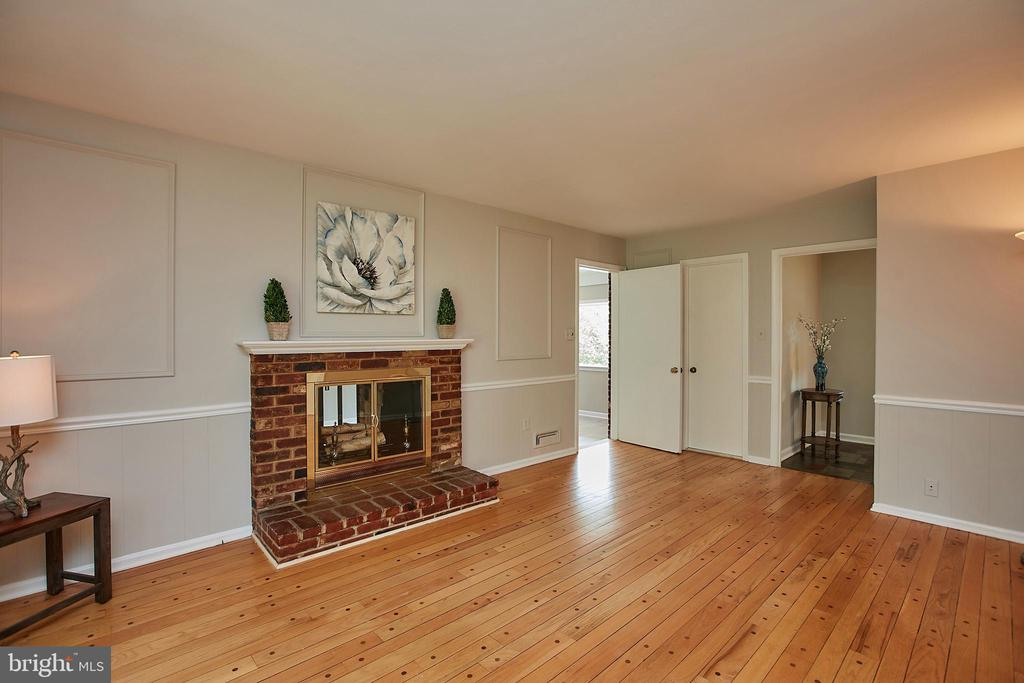 2 sided Fireplace for casual space off Kitchen - 2430 CARON LN, FALLS CHURCH
