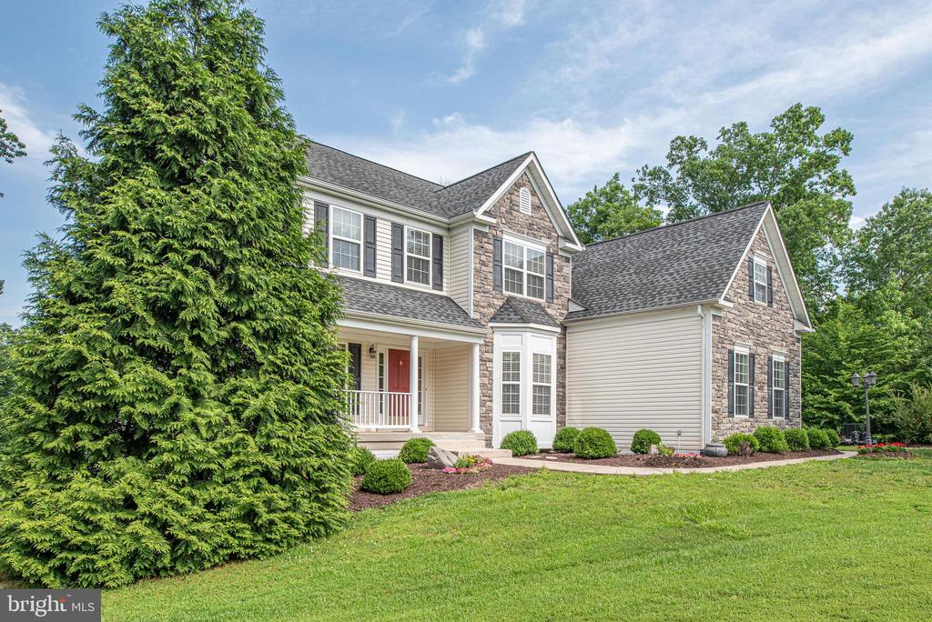 Mature trees surround the home for privacy. - 51 RIVER RIDGE LN, FREDERICKSBURG