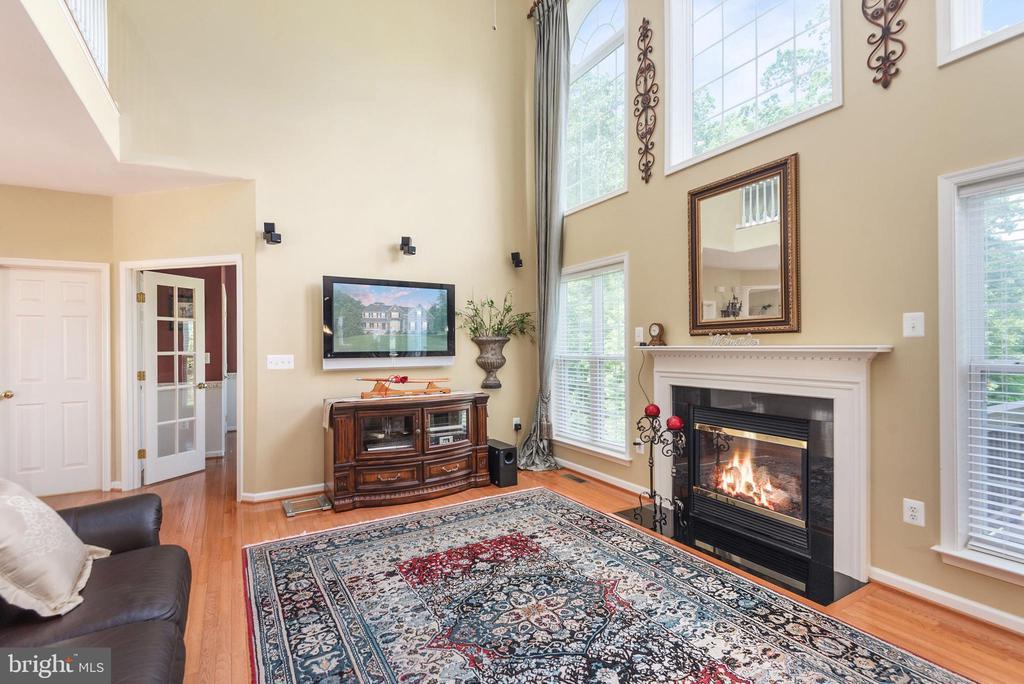 Open & inviting family room looking over backyard. - 51 RIVER RIDGE LN, FREDERICKSBURG