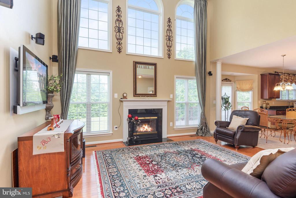 Two story family room with wall of windows. - 51 RIVER RIDGE LN, FREDERICKSBURG