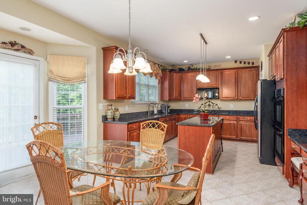 Kitchen and table area view. - 51 RIVER RIDGE LN, FREDERICKSBURG