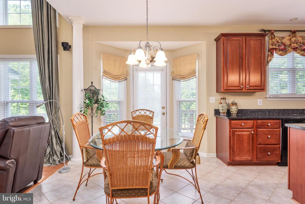 Table are with exterior door to backyard deck. - 51 RIVER RIDGE LN, FREDERICKSBURG
