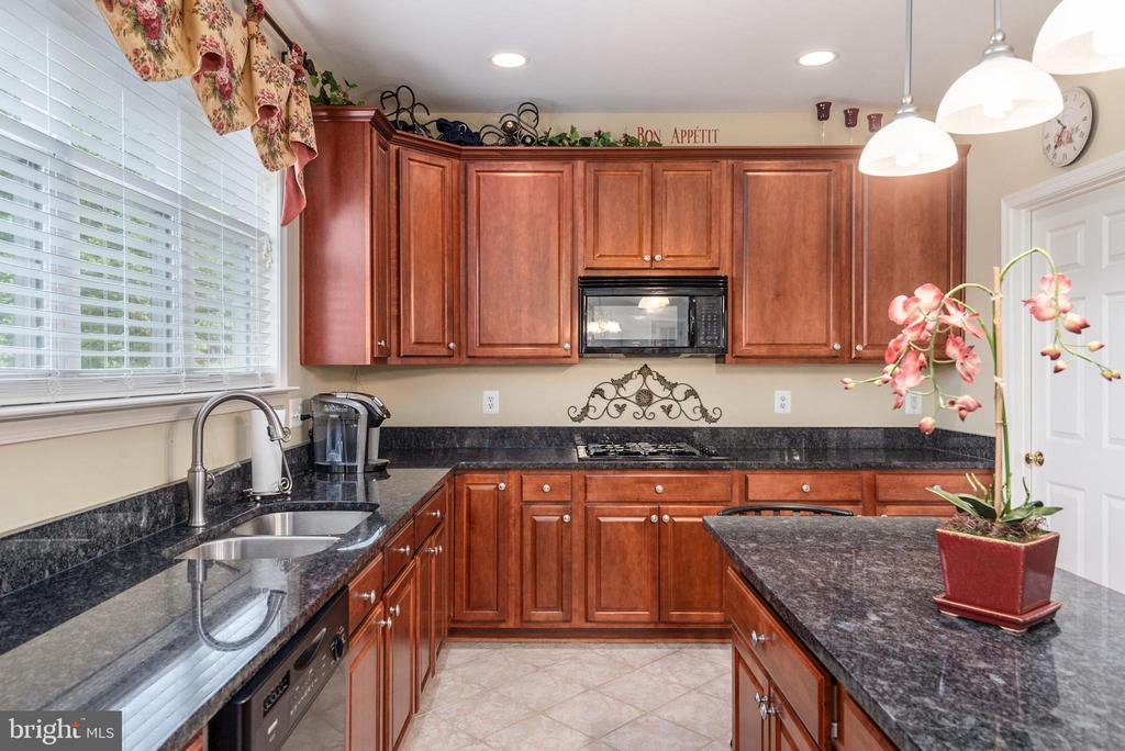 Cook top, island, ample cabinetry in kitchen. - 51 RIVER RIDGE LN, FREDERICKSBURG