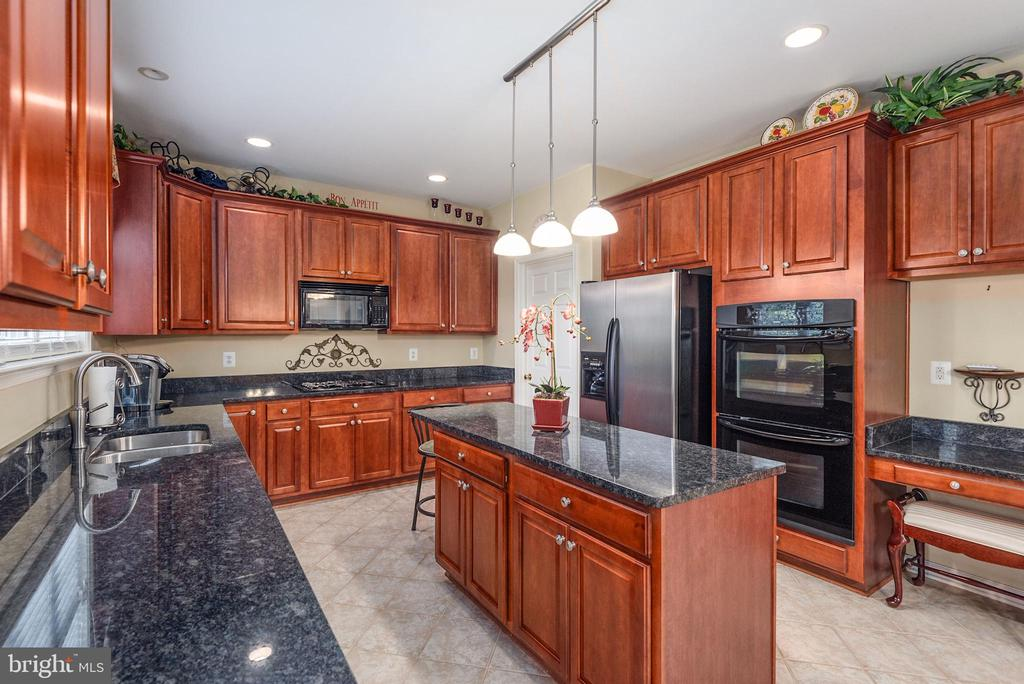 Double oven and desk area in kitchen. - 51 RIVER RIDGE LN, FREDERICKSBURG