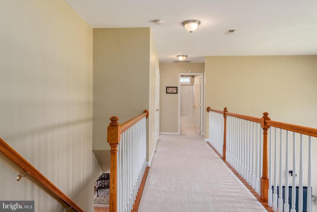Upper level hallway balcony overlooking family rm - 51 RIVER RIDGE LN, FREDERICKSBURG