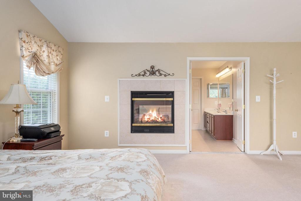 View from master of fireplace and master bath. - 51 RIVER RIDGE LN, FREDERICKSBURG