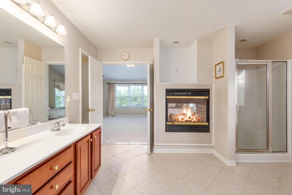 View of gas fireplace & shelf for TV, shower stall - 51 RIVER RIDGE LN, FREDERICKSBURG