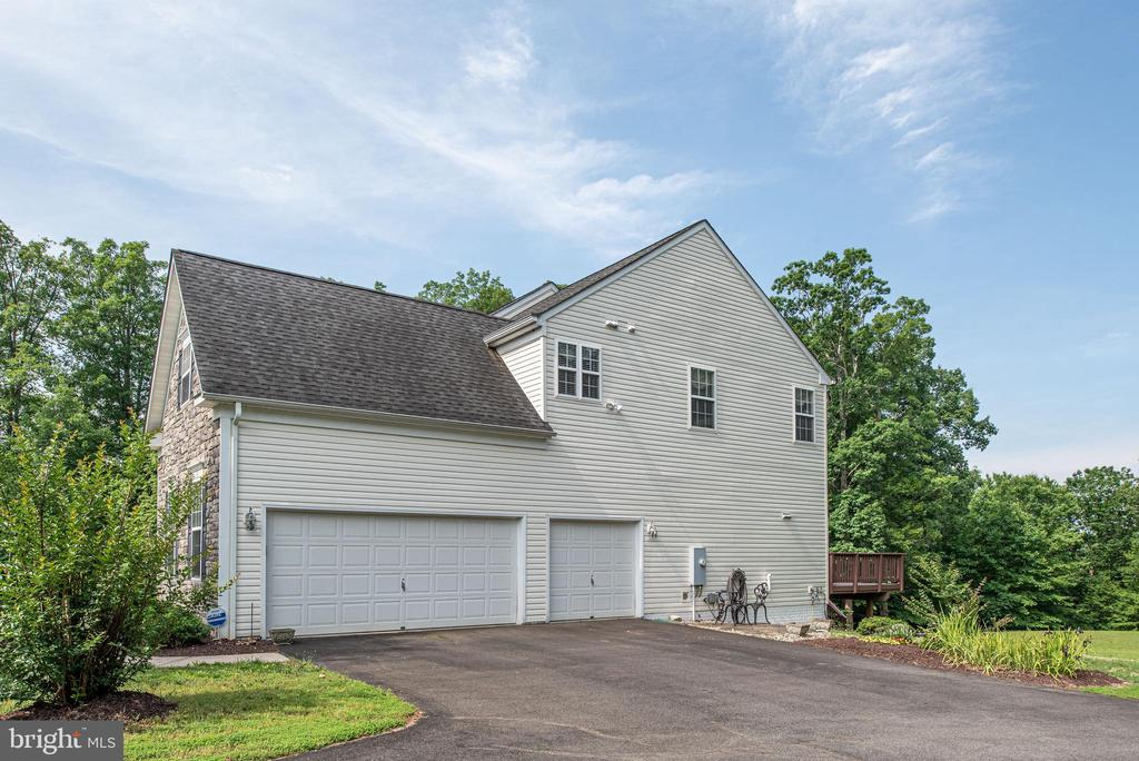 Three car garage with extended driveway. - 51 RIVER RIDGE LN, FREDERICKSBURG