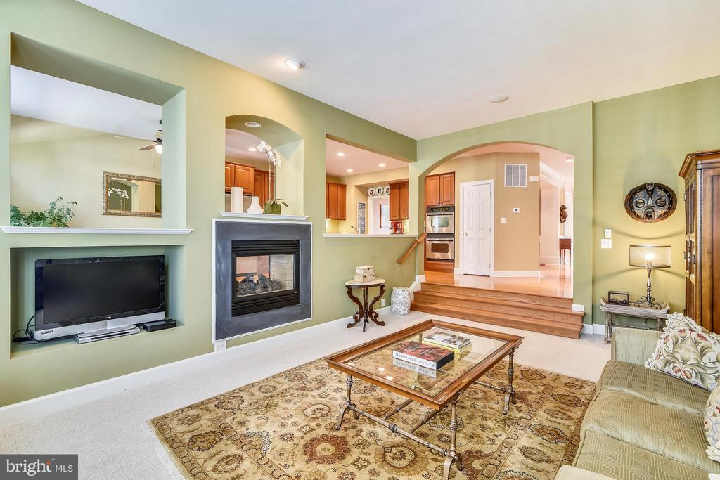Family Room with 2-sided gas fireplace - 43476 CASTLE HARBOUR TER, LEESBURG
