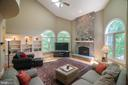 Spacious great room with custom stone fireplace. - 12009 BENNETT FARMS CT, OAK HILL