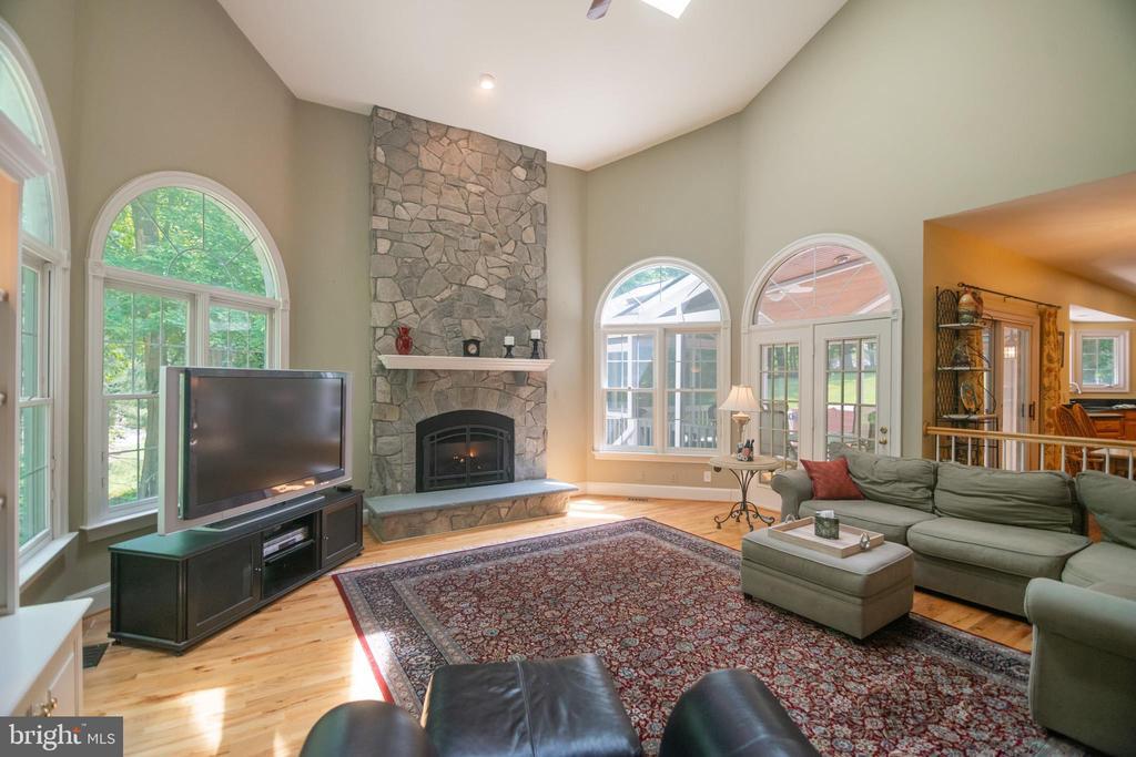 Great room features hardwood floors and skylight. - 12009 BENNETT FARMS CT, OAK HILL