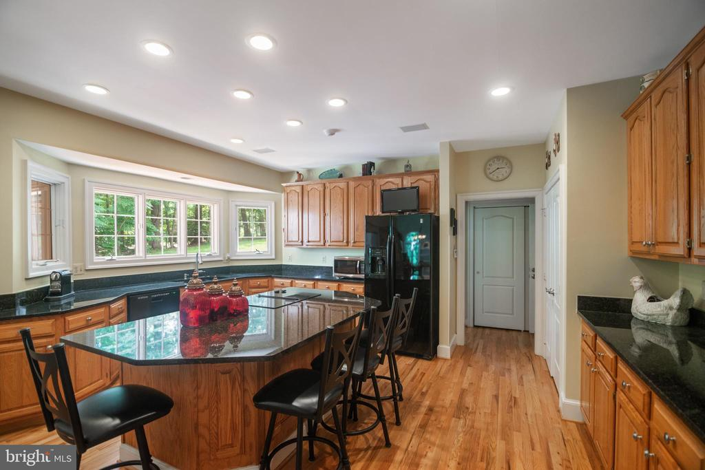 Gourmet kitchen with granite counter tops. - 12009 BENNETT FARMS CT, OAK HILL