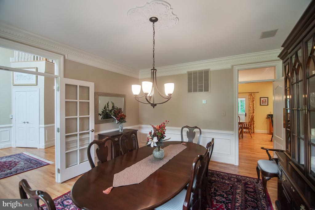 Separate dining room with chair & picture moulding - 12009 BENNETT FARMS CT, OAK HILL