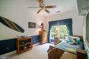 Fourth bedroom features a chair rail & ceiling fan - 12009 BENNETT FARMS CT, OAK HILL