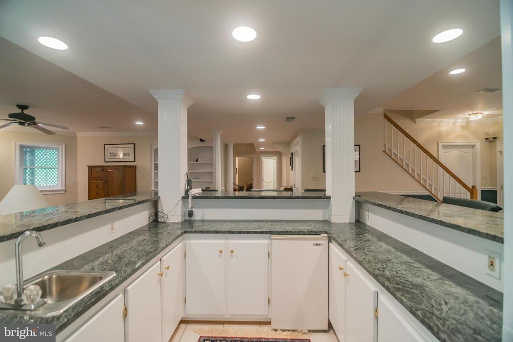 Large built-in bar in the lower level. - 12009 BENNETT FARMS CT, OAK HILL
