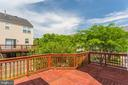 Large deck  overlooking yard open sky - 43657 SCARLET SQ, CHANTILLY