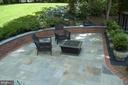 Beautiful slate patio off the deck. - 12009 BENNETT FARMS CT, OAK HILL