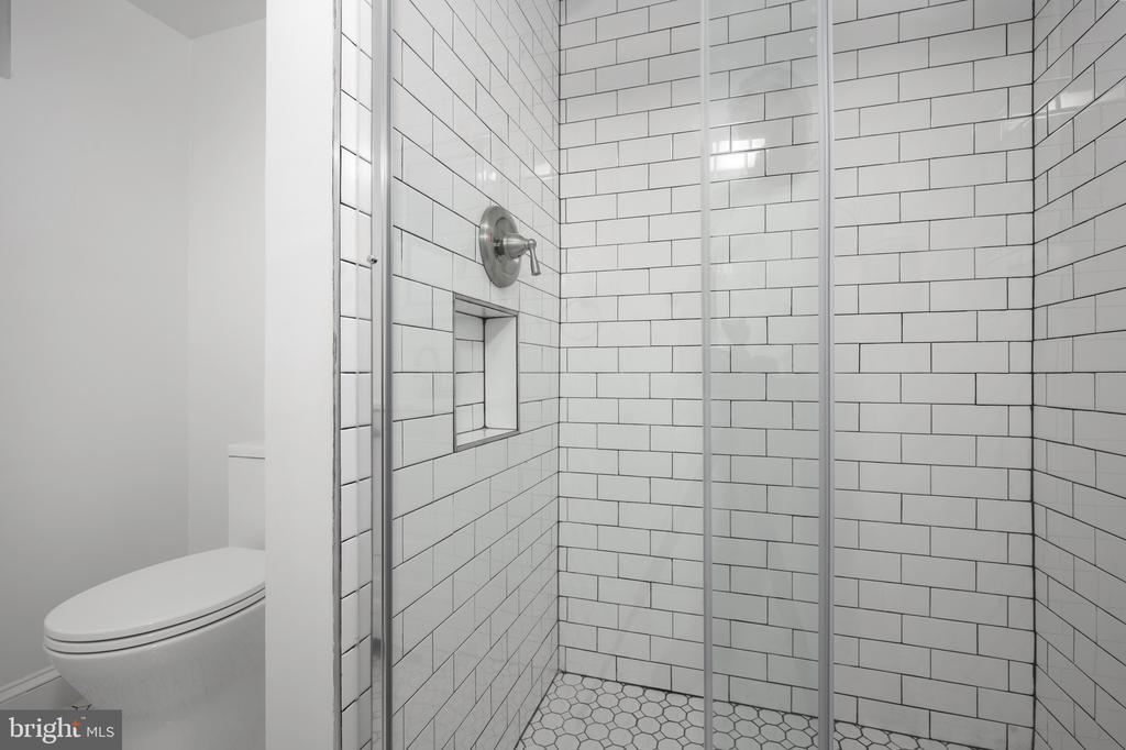 Lower level beautifully renovated full bath - 4861 BLAGDEN AVE NW, WASHINGTON