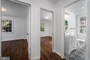 Hall view of bedrooms and bath - 4861 BLAGDEN AVE NW, WASHINGTON