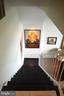 Stairway from entry down to living room - 1200 N NASH ST #855, ARLINGTON