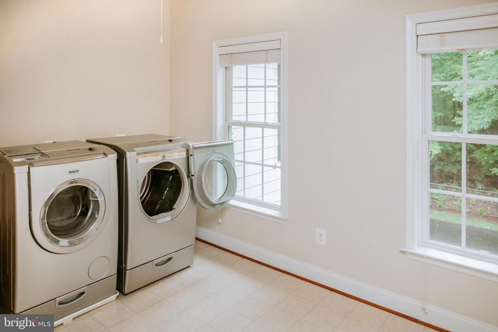 Upper-level laundry room- Bosch washer dryer - 4617 HOLIDAY LN, FAIRFAX