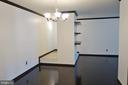 View of foyer and living room from dining room - 11236 CHESTNUT GROVE SQ #161, RESTON
