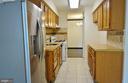 Kitchen w/ tile floors - 11236 CHESTNUT GROVE SQ #161, RESTON