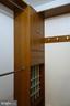 MBR walk in closet w/ custom shelving - 11236 CHESTNUT GROVE SQ #161, RESTON