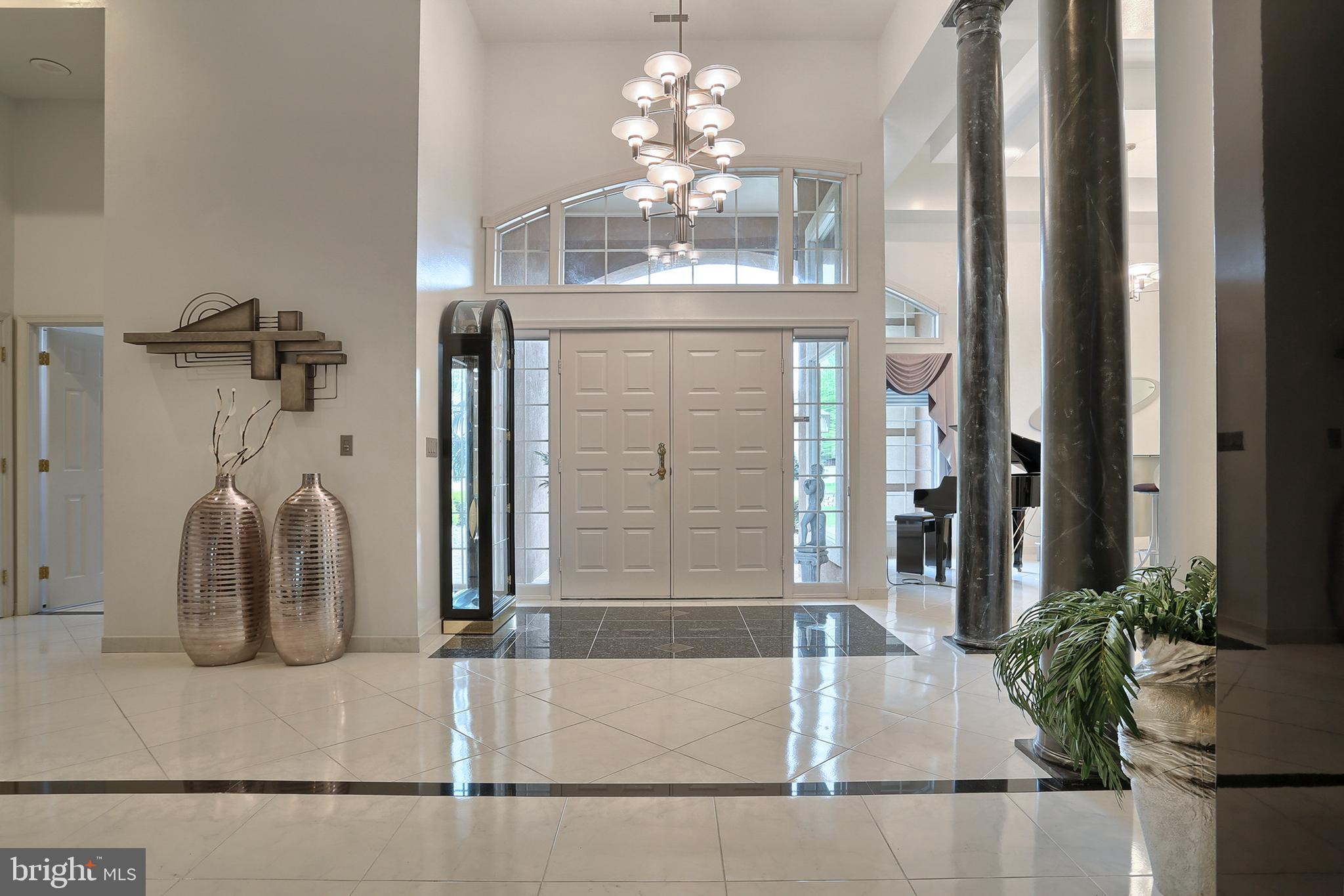 9' x 9' foyer with 14' ceilings and porcelain tile