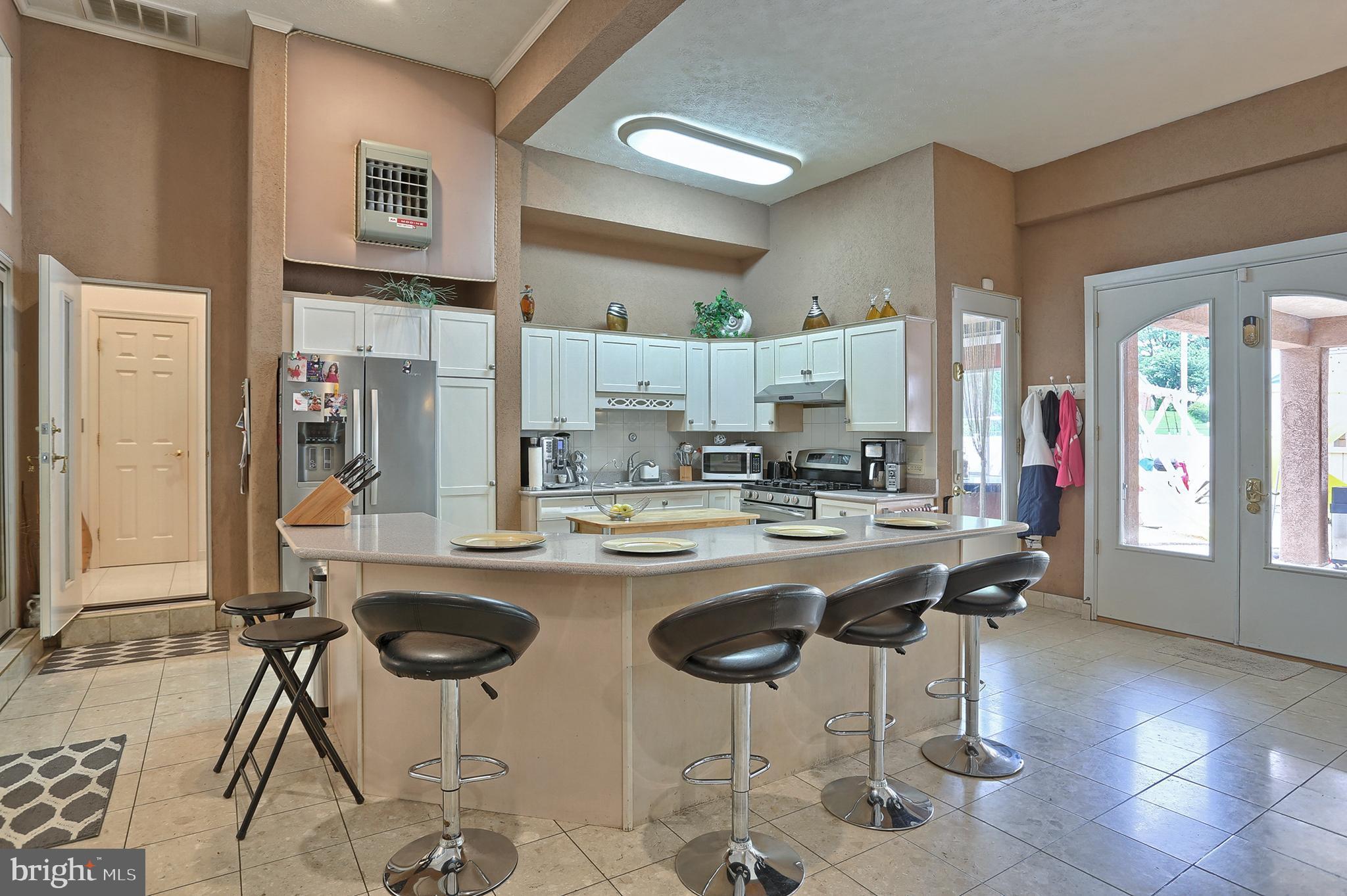 Corian breakfast bar in kitchen # 2  (21'x17')